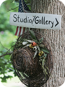 Sign to Blue Jacket Studio and Gallery